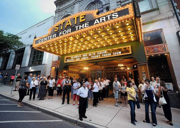 """Friends, family and supporters wait outside of the State Theatre in Easton for the arrival of Sgt. Adam Keys prior to the start of the Gary Sinise and the Lt. Dan Band benefit concert on Friday night. The concert also featured special guests Daniel Rodriguez """"America's Beloved Tenor,"""" and artist Scott LoBaido."""