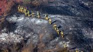 A U.S. Forest Service review of its response to the Station fire has concluded that the blaze raged out of control because it spread into terrain too steep for firefighters to safely confront the flames, but the inquiry failed to address key questions about the agency's actions on the critical second day of the battle.