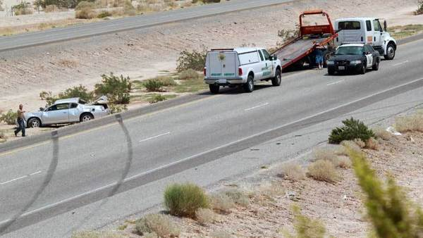 A car rests in the center divider of Interstate 8 near Dunaway Road east of Ocotillo after overturning during an accident in which a Calipatria State Prison inmate was killed Friday. The inmate was struck and killed while doing highway detail with the California Department of Transportation.