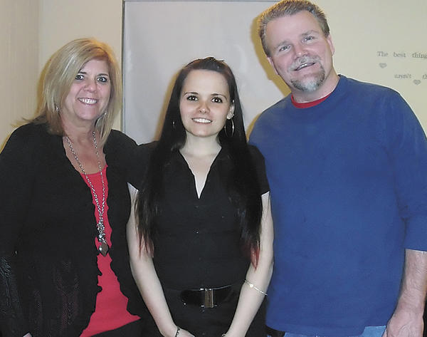 Alli Rogers of Salisbury, Md., center, stands with her parents, Linda and Bill Rogers of Mercersburg, Pa. Alli has lymphangiomatosis, which attacks the body's lymph system. Her parents will hold a fundraiser to help pay for Alli's medical bills.