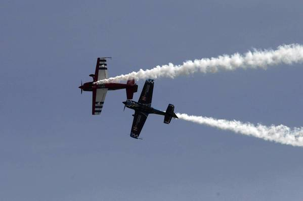 Members of Firebirds Delta Team perform over Lake Michigan during the Chicago Air and Water Show at North Avenue Beach.