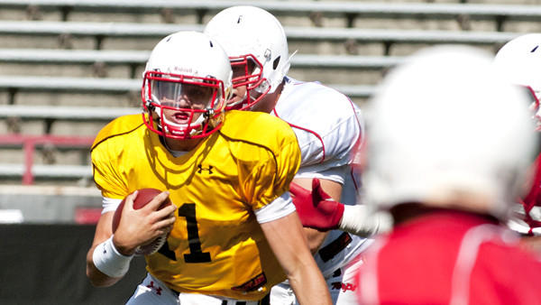 Freshman quarterback Perry Hills takes off on a run during the Terps' scrimmage Saturday at Byrd Stadium.