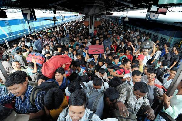 Northeastern Indians arrive in Guwahati, in the northeastern state of Assam, from Karnataka state in southern India. Many northeastern Indians living in the south are heading home after rumors of impending attacks spread via social media.