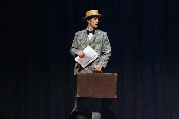 "Michael Thatcher performs onstage during the first scene of dress rehearsal of ""The Music Man"" at Hoover High School in Glendale."