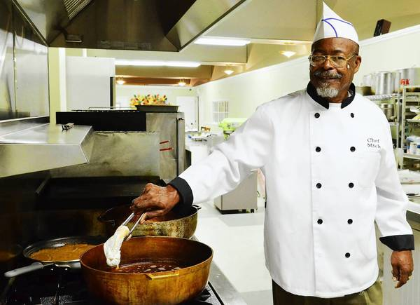 Chef Mick Lewis of Allentown cooks fried chicken in the kitchen of Taste of Soul at The Caring Coffee Cafe on Hamilton Street.