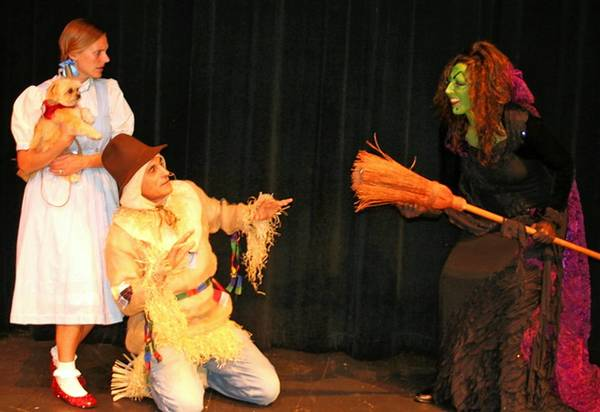 "Jocelyn Tuttle as Dorothy, John Ferrara as the Scarecrow and Lisa Spera as the Wicked Witch of the West star in September Song's production of ""The Wizard of Oz,"" opening this week at Winters Mill High School."