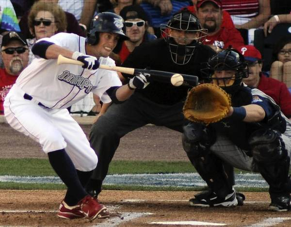 Kyle Hudson goes for a bunt on the first pitch of Saturday night's game. He was unable to get to first base safely. The Lehigh Valley IronPigs take on the Toledo Mud Hens at Coca-Cola Park in Allentown, Saturday, August 18, 2012