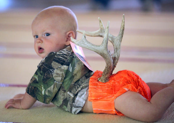 Six-month-old Dawson Krueger wasn't sure what all the fuss was about as he looked at the crowd reacting to his antler-clad diaper in the diaper decoration contest Saturday at the Brown County Fair. Krueger's hunting outfit took home first place in the 5-9-month-old division. Krueger is the son of Lona and Bryce Krueger, of Stratford. American News Photo by John Davis