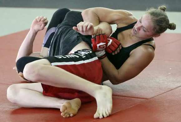 Ronda Rousey picked up another victory with her lethal armbar Saturday over Sarah Kaufman to successfully defend her Strikeforce title.