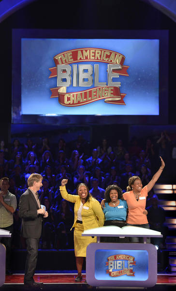 "Jeff Foxworthy celebrates with Team Minnie's Food Pantry in the series premiere of ""The American Bible Challenge,"" airing at 7 p.m. Aug. 23 on Game Show Network."