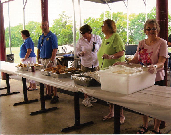 Club members April Reed, David Blitz, Pam Cole, Goldie Wilson and Faye Metger wait to serve food at the Tri-State Civitan Club's annual picnic.