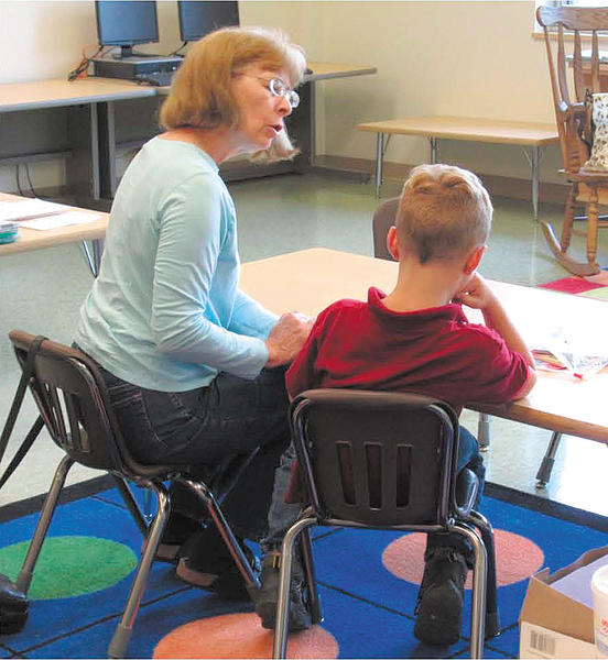 Nancy Patterson works with a student at Rockland Woods Elementary School during the summer.