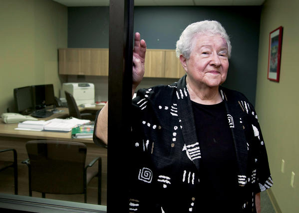 Janice Durflinger poses Aug. 1 for a photo at her workplace in Lincoln, Neb. She is still working at age 76, running computer software programs for a bank.