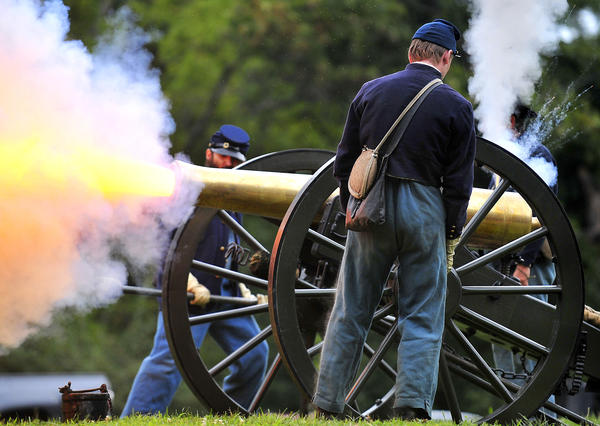 A demonstration of loading and firing a 12 pound Napoleon cannon takes place during Thunder on the Mountain at South Mountain State Battlefield Sunday.