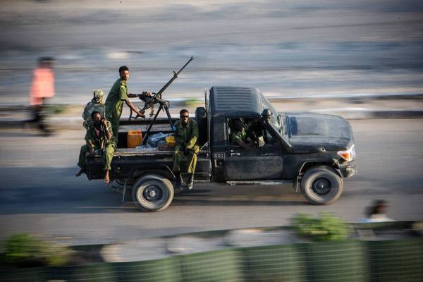 Somali soldiers race along a road near the parliament building this month. On Monday, the new parliament will choose the troubled nation's next president.