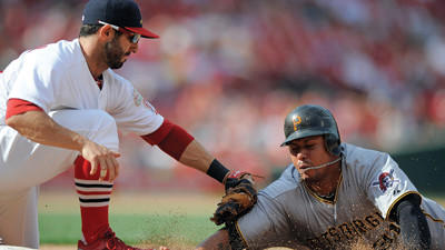 Pittsburgh Pirates' Jose Tabata, right, is tagged out by St. Louis Cardinals first baseman Daniel Descalso on a pickoff throw on Sunday.