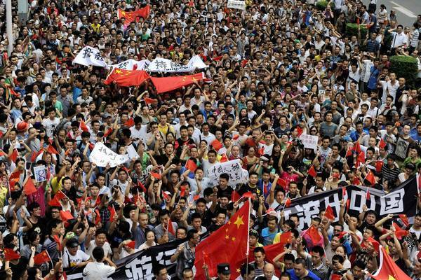 Protesters in Chengdu, China, march Sunday in an anti-Japanese rally stemming from a long-standing dispute over uninhabited islands claimed by both countries. Chinese protesters rallied in more than a dozen cities.