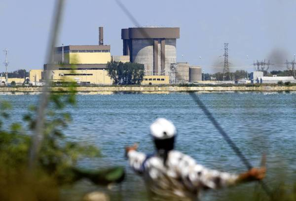 An angler tries her luck across the 2,500-acre cooling pond at the Braidwood Nuclear Plant in Will County.