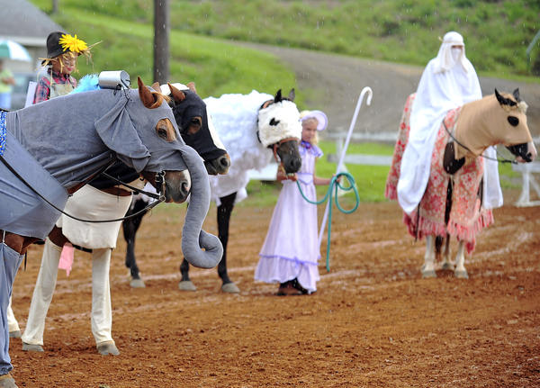 Junior costume competitors line up Sunday for judging during the youth horse show at the Franklin County (Pa.) Fair off Pa. 995 near Chambersburg, Pa.