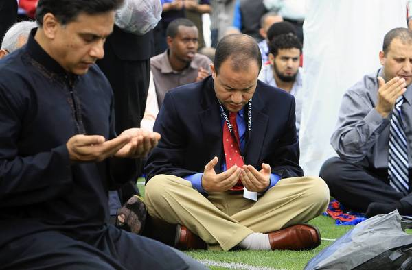 Dr. Zaher Sahloul joins thousands of other Muslims on Sunday at Toyota Park in Bridgeview to observe the end of Ramadan at an Eid al-Fitr celebration.
