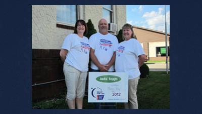 Windber Moose Relay For Life team members Susan Shaffer, Jim Cobaugh and Carol Maluchnik stand behind a sign they received from the American Cancer Society for raising more than $10,000 to help in the battle against cancer.