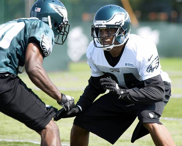 Cornerback Nnamdi Asomugha (right) and the rest of the Eagles secondary need to step up their tackling if the defense is to be effective.
