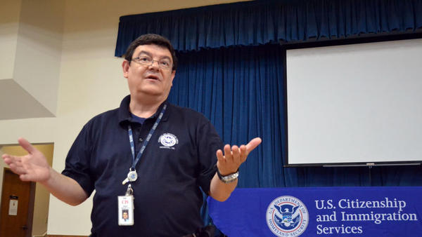 Alfonso De Los Cobos, representing the U.S. Department of Homeland Security Citizenship and Immigration Services, presents an immigration workshop to help with legal permanent residency and how to establish getting a green card. It was held Saturday afternoon at St. Mary's Catholic Church on La Brucherie Road in El Centro.