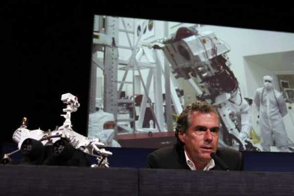 Mike Watkins discusses the deployment of the Curiosity rover's main mast on the surface of Mars during a news conference at NASA's Jet Propulsion Laboratory.