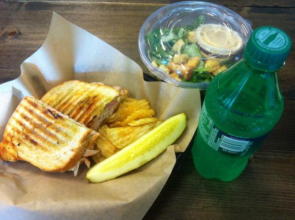 The Brown Bag Sandwich Co. serves a core menu of 10 $9 sandwiches, including the turkey pesto sandwich seen here with turkey, Provolone cheese, basil pesto, red onions and roasted red peppers on rosemary bread. A side Caesar salad is $5, while most non-alcoholic beverages are $2 apiece.
