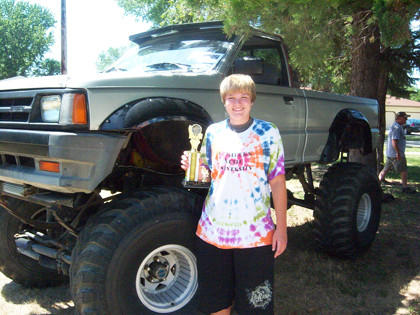 Kelsey Sayler of Aberdeen was the People's Choice Award winner at Langford's Show and Shine on July 22. Sayler is pictured with the 1987 Mazda pickup.