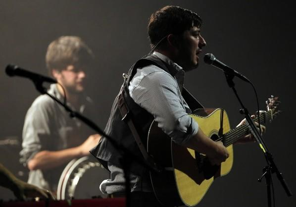 Mumford & Sons' Marcus Mumford (right) and Winston Marshall (left) play the Chicago Theatre Aug. 16, 2012.