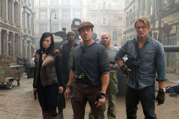 """The Expendables 2"" stars include, from left, Yu Nan, Terry Crews, Sylvester Stallone, Randy Couture and Dolph Lundgren, shown here after surviving an ambush in a Soviet-era recreation of New York City."