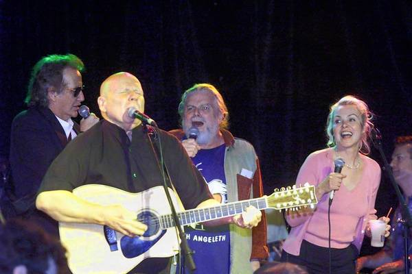 In March 2001, Scott McKenzie, second from right, joined friends and colleagues at the Roxy in Los Angeles for a tribute to Mamas & the Papas leader John Phillips, who had recently died. On stage with McKenzie are John Stewart, left, Barry McGuire, front, and Michelle Phillips.