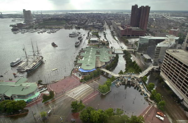 The Inner Harbor flooded in the wake of Tropical Storm Isabel in 2003. With sea level projected to rise 1.5 feet by 2050 and 3.5 to 5 feet by century's end, coastal communities face costly and difficult choices.
