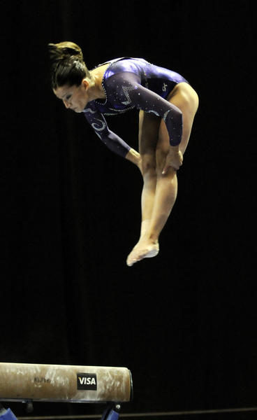 Local favorite Alicia Sacramone dismounts off the balance beam during the women's senior gymnastics competiton during the 2010 VISA Gymnastics Championships being held at the XL Center