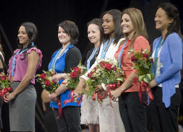 Newly medaled, the 2000 US Olympic gymnastics team of (L-R) Tasha Schwikert, Elise Ray, Kristen Maloney, Dominique Dawes, Jamie Dantzscher and Amy Chow stand in line after receiving bronze medals after an IOC ruling this April stripped the medal from China for age ineligibilty.
