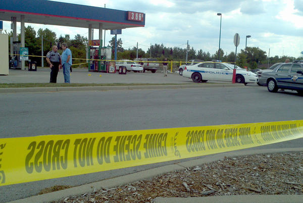 Police tape surrounds the scene where police shot and wounded a suspect fleeing from the Stanford Wal-Mart Monday afternoon.