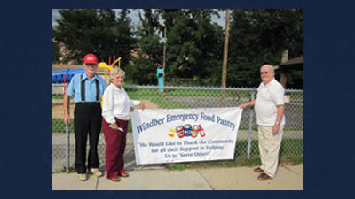 A new sign is being placed along Graham Avenue in Windber to thank the many people for their donations to the Windber Emergency Food Pantry. On hand to place the banner are George Penrod, on left, the vice president of the food pantry, Dee Chicarell, Windber Emergency Food Pantry manager, and Bob Lehman, the president.