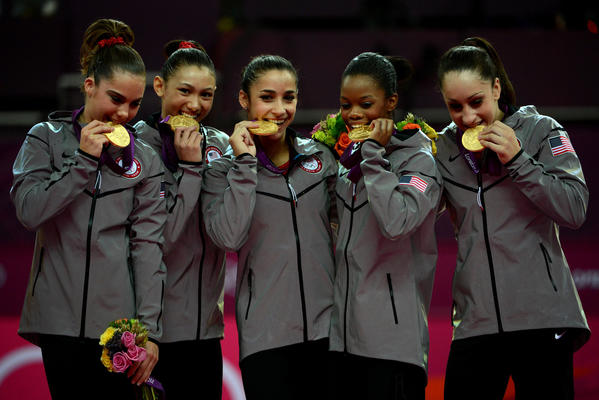 The U.S. women's gymnastics team, from left, McKayla Maroney, Kyla Ross, Alexandra Raisman, Gabby Douglas and Jordyn Wieber pose with their gold medals after winning the women's gymnastics team final during the Summer Olympic Games in London.