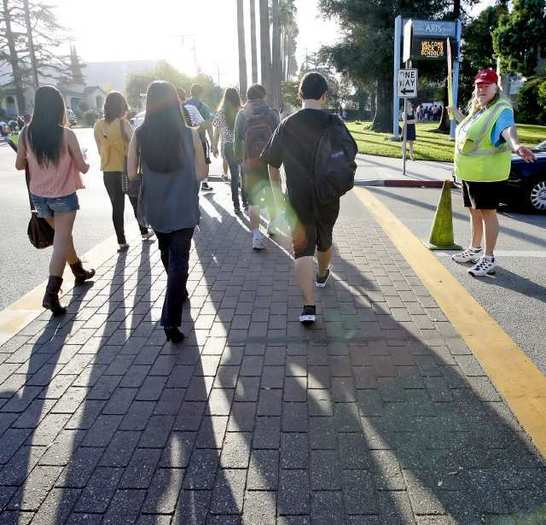 Students walk to Hoover High School in Glendale on Monday, Aug. 20.