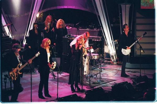Fleetwood Mac perform after their induction into the Rock and Roll Hall of Fame.