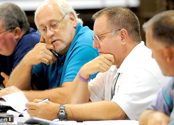 Paul Miller, left, chairman of the task force to study the Fairplay Volunteer Fire Co., and Charles R. Summers, deputy director of the Washington County Division of Emergency Services, ask questions during Monday night's meeting at the Washington County Agricultural Education Center near Sharpsburg.