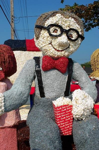 A giant likeness of Orville Redenbacher, made of thousands of popped and dyed kernels, makes its way along the parade route in Valparaiso, Indiana.