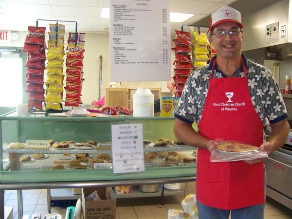 Paul Evers, a longtime volunteer at the First Christian Church pie stand at the Emmet-Charlevoix County Fair, will greet customers throughout the week. The church has been selling pies at the fair for more than 70 years.