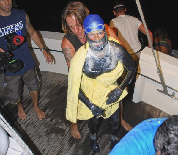 Endurance swimmer Diana Nyad is aided after she was pulled out of the water between Cuba and the Florida Keys early August 21, 2012. Nyad abandoned her fourth attempt to swim from Cuba to Florida on Tuesday after battling lightning storms and swarms of jellyfish.
