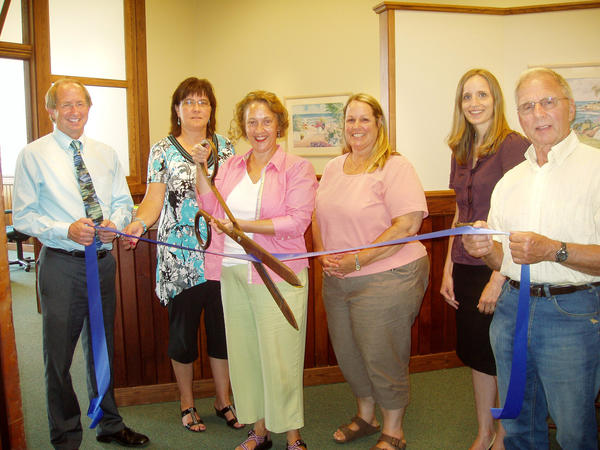 Chris Krajewski (third from left), Womens Resource Center of Northern Michigan Domestic Abuse and Sexual Assault Program Director recently participated in a ribbon cutting for the agencys new satellite office in East Jordan. Also pictured are (from left) Dave Atkins, vice president of Charlevoix State Bank; Mary Faculak, East Jordan Chamber President; Krajewski; Deb Smith, womens center assistant director; Jen Rashleigh-Houser, womens center counselor-advocate; and Floyd Wright of Wright Builders, Inc. and co-owner of Main Street Center, East Jordan.
