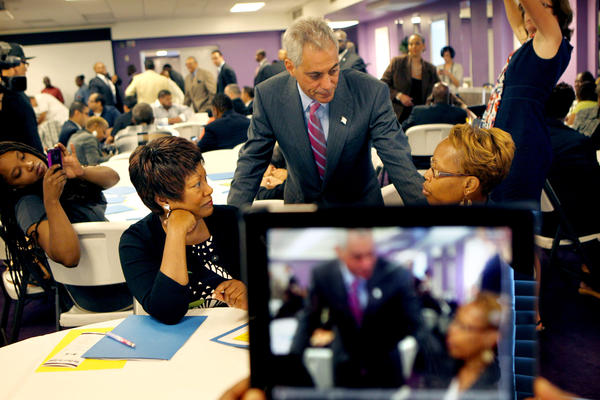 Mayor Rahm Emanuel goes from table to table shaking hands with pastors at an interfaith Back to School breakfast, also attended by Jean-Claude Brizard, CEO of the Chicago Public Schools, at the Greater Harvest Church in Chicago.