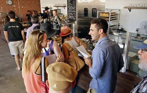 Customers line up to order at Sycamore Kitchen bakery cafe.