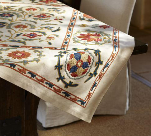 This Mila Suzani embroidered table throw from Pottery Barn for $159 allows you to show off the surface of your table, too. And it demonstrates our affinity for the wonderful craftsmanship from other rich cultural traditions, says interior designer Debbie McHale. Its heavy pattern will look great with solid dishes, says designer Liz Dickson.