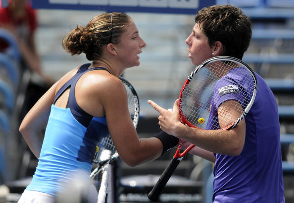 Sara Errani, left, of Italy defeated Carla Suarez Navarro of Spain in straight sets 6-4, 6-3, during their second round match Tuesday at the New Haven Open at Yale tennis tournament.
